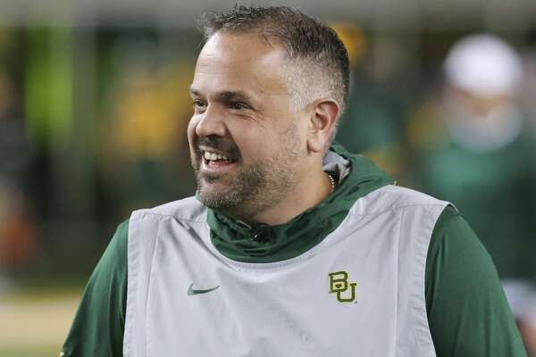 Baylor head coach Matt Rhule stands on the field prior to an NCAA college football game against Oklahoma in Waco, Texas, Saturday, Nov. 16, 2019. (AP Photo/Ray Carlin)