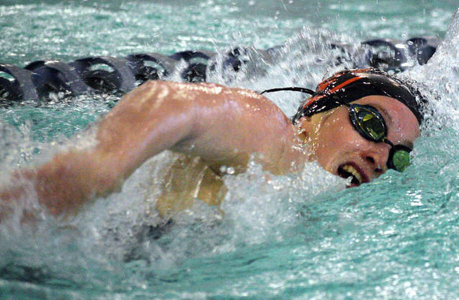 Edwardsville junior Josie Bushell is on her way to a first-place finish in the 100-yard freestyle on Saturday during the Springfield High Sectional at Eisenhower Pool. Photo: Scott Marion/The Intelligencer