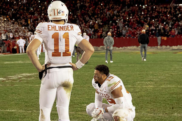 Texas quarterback Sam Ehlinger (11) and defensive back Brandon Jones (19) react after Iowa State scored a game-winning field goal as time expired to win 23-21 in an NCAA college football game, Saturday, Nov. 16, 2019, in Ames, Iowa. (Nick Wagner/Austin American-Statesman via AP)