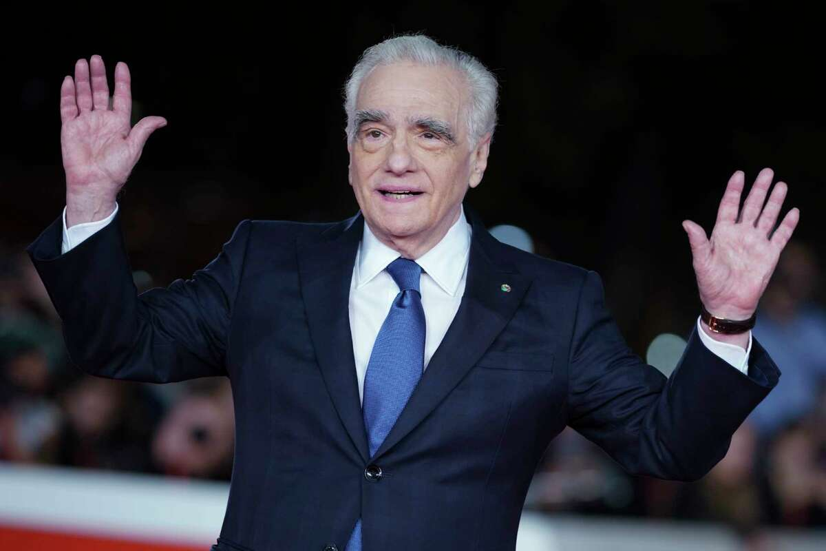 Director Martin Scorsese poses on the red carpet of the movie