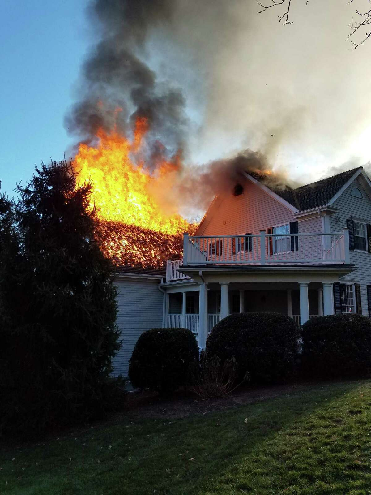 Fire rages through a mansion on Dan's Highway in New Canaan Saturday afternoon. Firefighters from New Canaan, Norwalk, Wilton as well as Pound Ridge, N.Y., South Salem, N.Y. and Vista, N.Y. fought the blaze for at least 90 minutes before bringing it under control. They continued to watch for flare-ups during the night.
