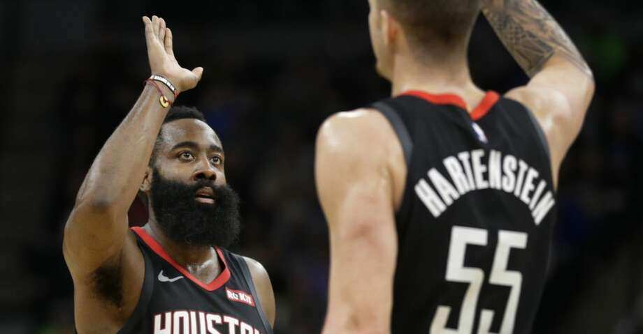 Houston Rockets guard James Harden is congratulated by Houston Rockets center Isaiah Hartenstein (55) in the fourth quarter during an NBA basketball game against Minnesota Timberwolves Saturday, Nov. 16, 2019 in Minneapolis. The Rockets defeated the Timberwolves 125-105 with Harden scoring a game-high 49 points. (AP Photo/Andy Clayton- King) Photo: Andy Clayton-King/Associated Press