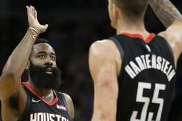 Houston Rockets guard James Harden is congratulated by Houston Rockets center Isaiah Hartenstein (55) in the fourth quarter during an NBA basketball game against Minnesota Timberwolves Saturday, Nov. 16, 2019 in Minneapolis. The Rockets defeated the Timberwolves 125-105 with Harden scoring a game-high 49 points. (AP Photo/Andy Clayton- King)