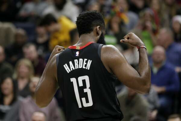 Houston Rockets guard James Harden (13) flexes after scoring and getting fouled against Minnesota Timberwolves in the fourth quarter during an NBA basketball game Saturday, Nov. 16, 2019 in Minneapolis. The Rockets defeated the Timberwolves 125-105 with Harden scoring a game-high 49 points. (AP Photo/Andy Clayton- King)