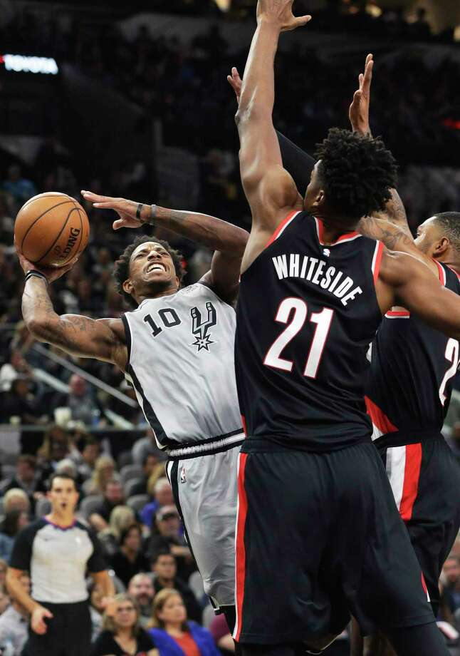 DeMar DeRozan leans back for shot after being fouled going to the hoop as the Spurs play Portland at the AT&T Center on Nov.16, 2019. Photo: Tom Reel, San Antonio Express-News / Staff Photographer / **MANDATORY CREDIT FOR PHOTOG AND  SAN ANTONIO EXPRESS-NEWS/NO SALES/MAGS OUT/TV