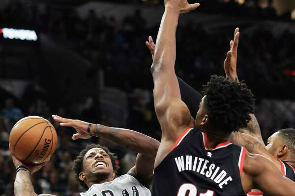 DeMar DeRozan leans back for shot after being fouled going to the hoop as the Spurs play Portland at the AT&T Center on Nov.16, 2019.