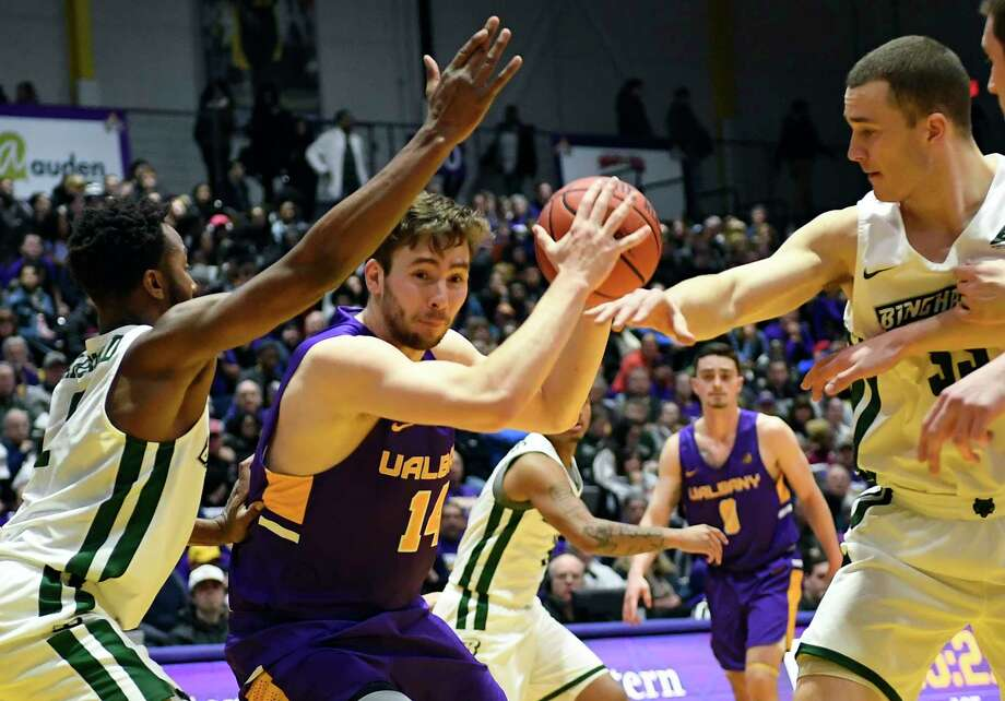 University at Albany forward Adam Lulka (14) moves the ball against Binghamton during the first half of an NCAA college basketball game Saturday, Feb. 2, 2019, in Albany, N.Y. (Hans Pennink / Special to the Times Union) Photo: Hans Pennink / 20045813A