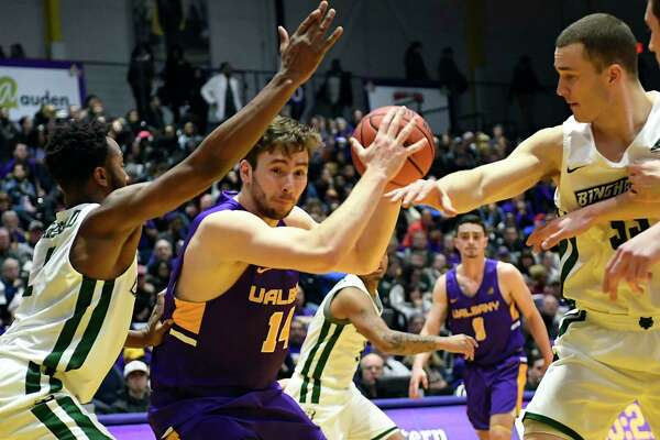 University at Albany forward Adam Lulka (14) moves the ball against Binghamton during the first half of an NCAA college basketball game Saturday, Feb. 2, 2019, in Albany, N.Y. (Hans Pennink / Special to the Times Union)