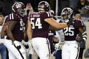 Texas A&M running back Cordarrian Richardson (25) celebrates with offensive lineman Carson Green (54) and teammates after catching a touchdown pass against South Carolina during the second quarter of an NCAA college football game Saturday, Nov. 16, 2019, in College Station, Texas. (AP Photo/David J. Phillip)
