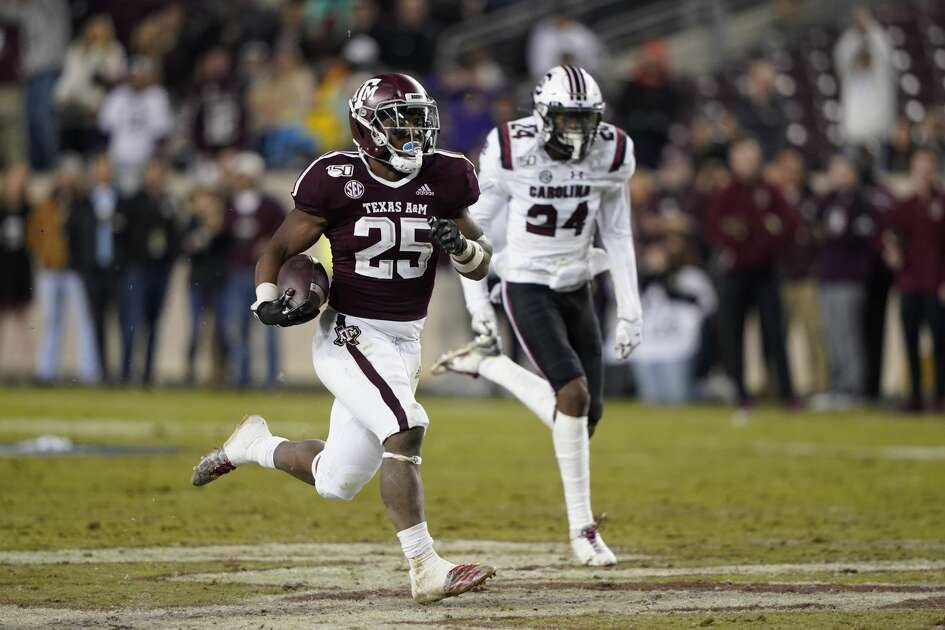 Texas A&M running back Cordarrian Richardson (25) runs for a 75-yard touchdown as South Carolina defensive back Israel Mukuamu (24) chases him during the second half of an NCAA college football game Saturday, Nov. 16, 2019, in College Station, Texas. (AP Photo/David J. Phillip)