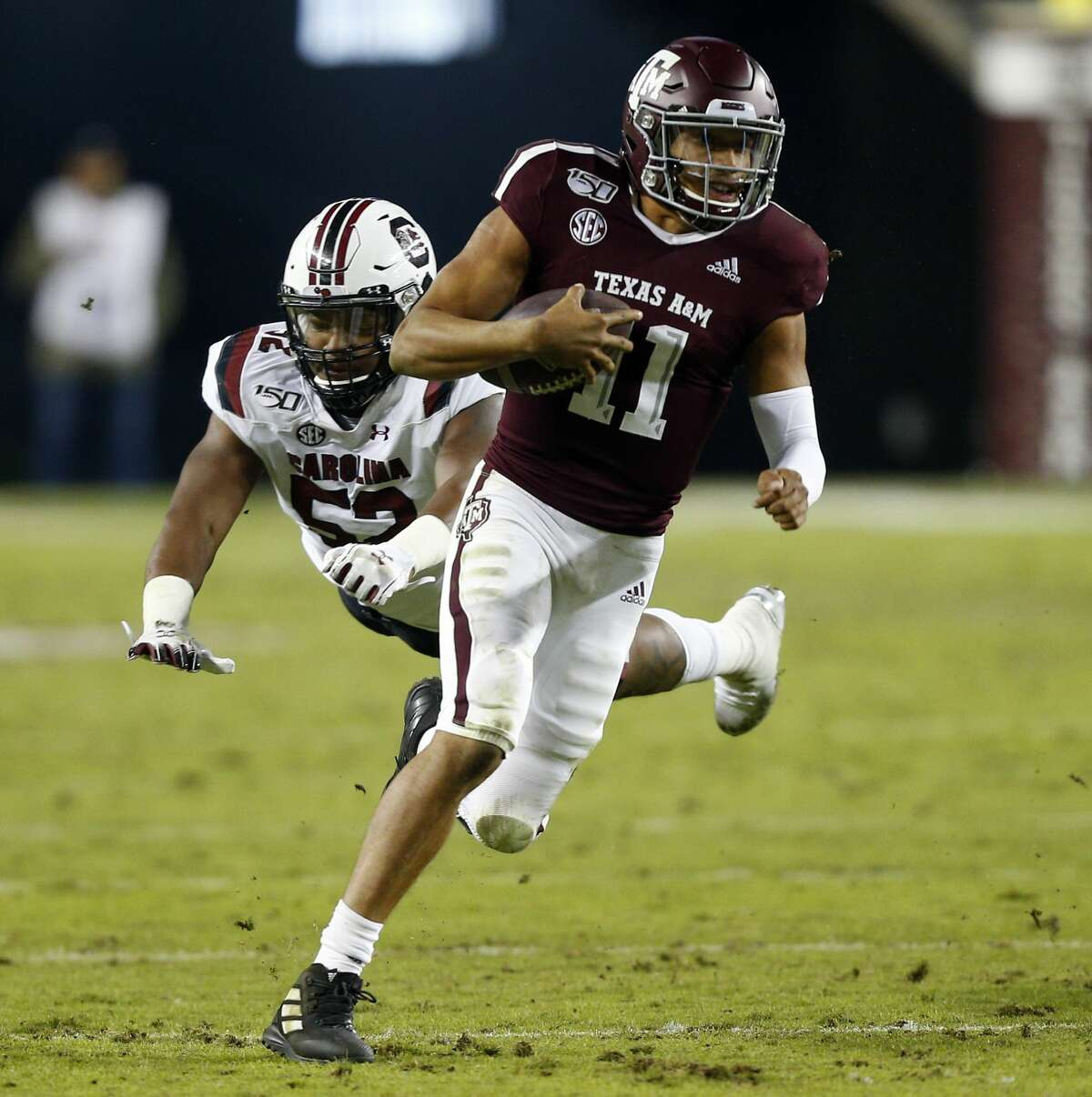 COLLEGE STATION, TEXAS - NOVEMBER 16: Kellen Mond #11 of the Texas A&M Aggies runs with the ball as Kingsley Enagbare #52 of the South Carolina Gamecocks attempts to make a tackle at Kyle Field on November 16, 2019 in College Station, Texas. (Photo by Bob Levey/Getty Images)