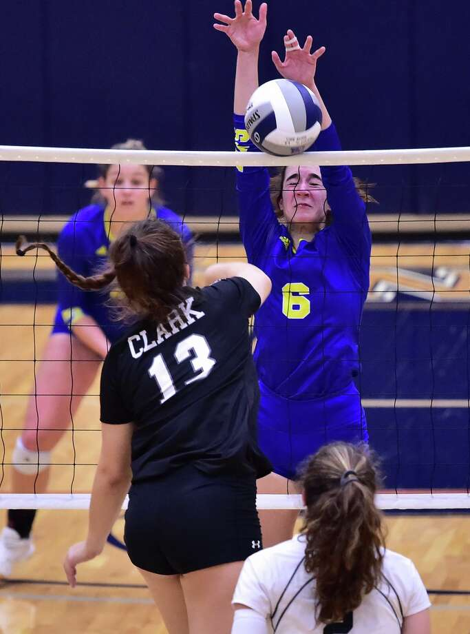 Clemens Melinda Hackethorn (6) blocks a shot by Clark's Mackenzie Wolff (13) during their Region IV-6A volleyball finals match at the Alamo Convocation Center Saturday. Photo: Robin Jerstad, San Antonio Express-News / Contributor / **MANDATORY CREDIT FOR PHOTOG AND SAN ANTONIO EXPRESS-NEWS/NO SALES/MAGS OUT/TV