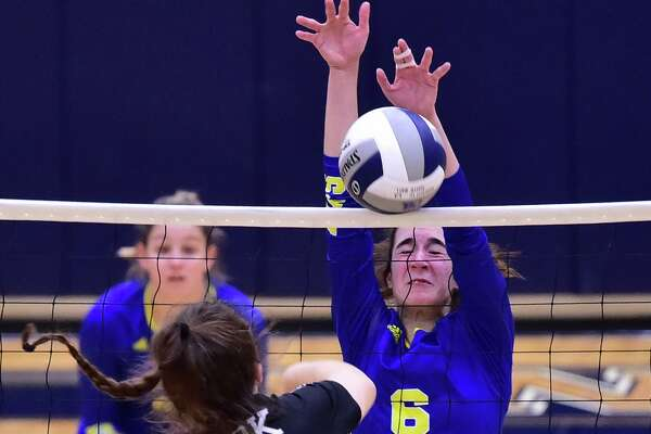 Clemens Melinda Hackethorn (6) blocks a shot by Clark's Mackenzie Wolff (13) during their Region IV-6A volleyball finals match at the Alamo Convocation Center Saturday.