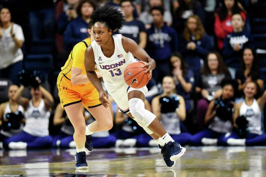 Christyn Williams (13) drives to the basket in the second half of UConn's win over California on Sunday, Nov. 10 in Storrs. Photo: Stephen Dunn / Associated Press / Copyright 2019 The Associated Press. All rights reserved
