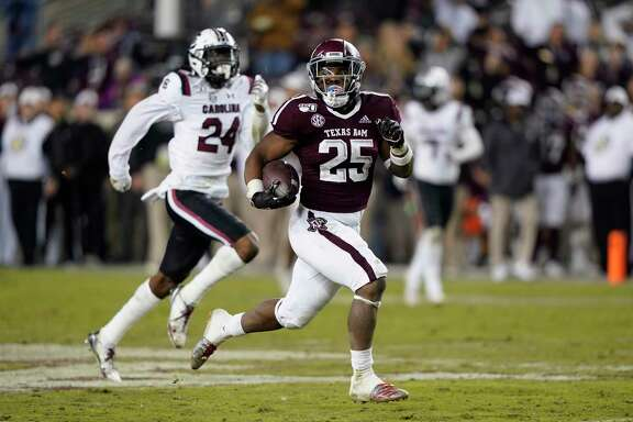 Texas A&M's Cordarrian Richardson breaks free on 75-yard touchdown run against South Carolina on Saturday night. Richardson finished with a game-high 130 yards rushing.
