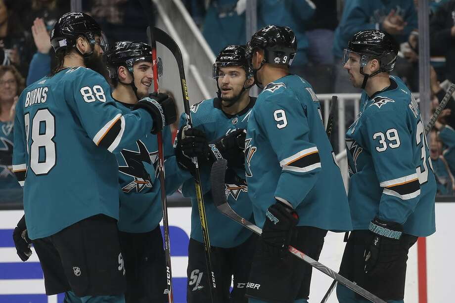 Sharks right wing Kevin Labanc (center) is congratulated by teammates after scoring a goal against the Detroit Red Wings during the first period at SAP Center on Saturday, Nov. 16, 2019. Photo: Jeff Chiu / Associated Press