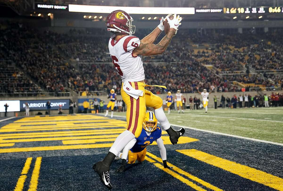Michael Pittman Jr. #6 of the USC Trojans catches a touchdown pass over Elijah Hicks #3 of the California Golden Bears during the second quarter of an NCAA football game at California Memorial Stadium on November 16, 2019 in Berkeley.
