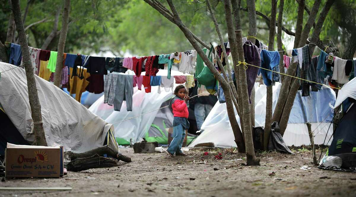 A young girl plays outside her family's tents at the refugee camp for asylum seekers in Matamoros on Thursday, Nov. 14, 2019.
