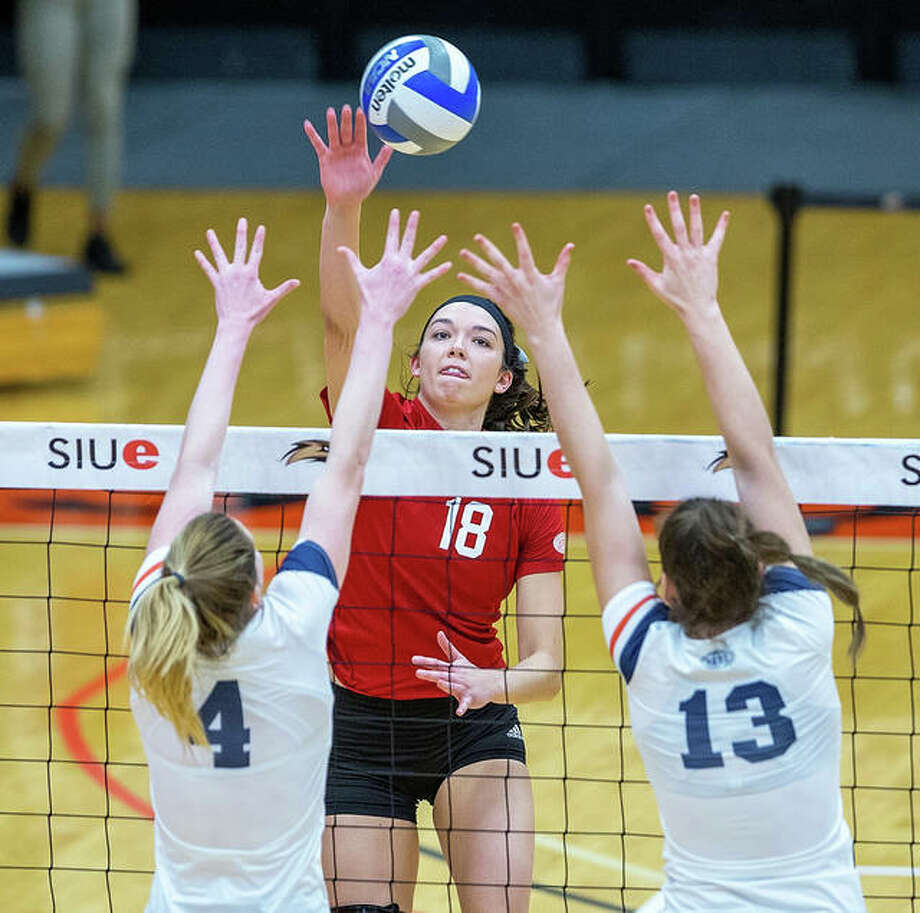 SIUE's Annie Ellis (18), a junior redshirt from Edwardsville, hits over the double block from UT Martin in an OVC women's volleyball match Saturday at First Community Arena in Edwardsville. Photo: Scott Kane / SIUE Athletics