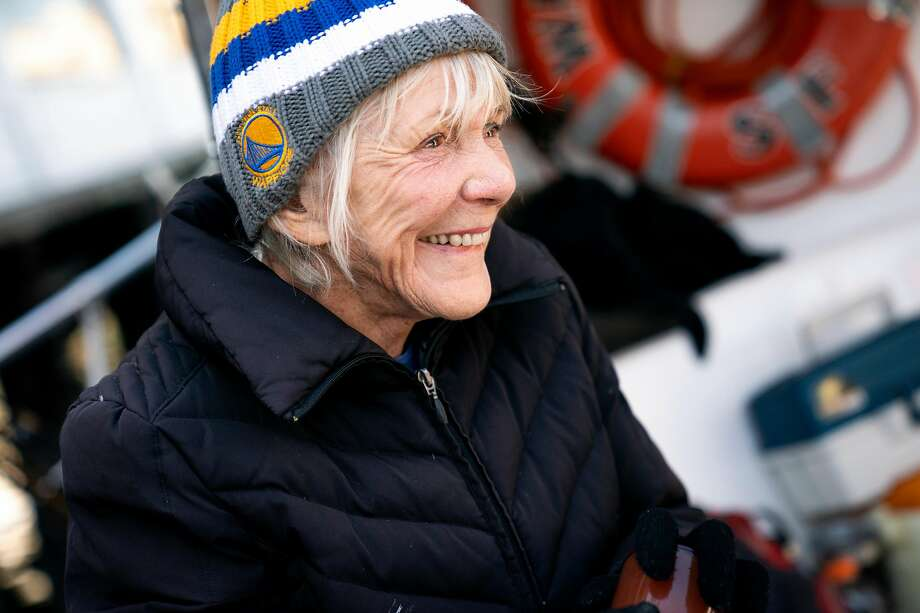 """Jacqueline Douglas, captain of the """"Wacky Jacky,"""" chats with her guests during a 2018 boat trip. Photo: Santiago Mejia / The Chronicle 2018"""