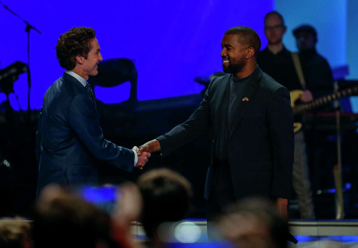 Joel Osteen welcomes Kanye West to the stage during the morning service at Lakewood Church Sunday, Nov. 17, 2019, in Houston. West talked with Osteen about overcoming adversity and his faith journey.