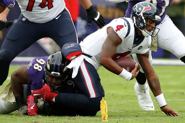 Houston Texans quarterback Deshaun Watson (4) is sacked by Baltimore Ravens defensive end Brandon Williams (98) during the first quarter of an NFL football game at M&T Bank Stadium on Sunday, Nov. 17, 2019, in Baltimore.