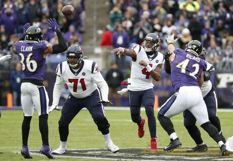 Houston Texans quarterback Deshaun Watson (4) throws a pass overt Baltimore Ravens defensive back Chuck Clark (36) during the first quarter of an NFL football game at M&T Bank Stadium on Sunday, Nov. 17, 2019, in Baltimore.