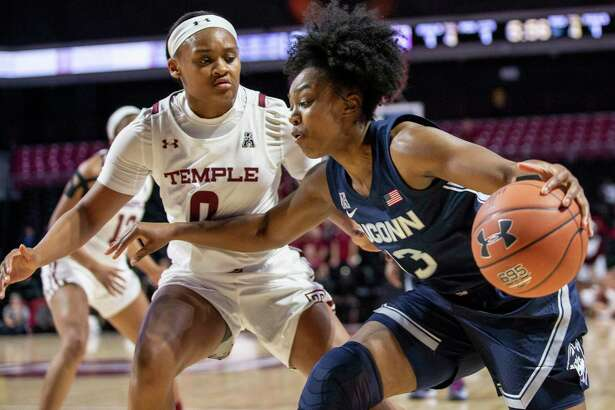 UConn guard Christyn Williams (13) moves around Temple guard Ashley Jones (0) during the first half Sunday, Nov. 17, 2019 in Philadelphia.