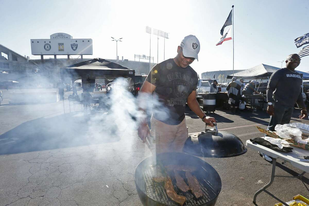 Oakland Raiders tailgate before the start of an NFL football game against the Cincinnati Bengals in Oakland, Calif., Sunday, Nov. 17, 2019. (AP Photo/D. Ross Cameron)