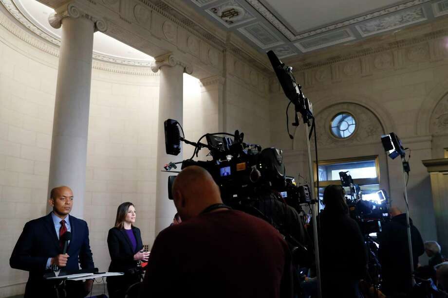 Television reporters report at the Longworth House Office Building where former U.S. Ambassador to Ukraine Marie Yovanovitch is testifying to the House Intelligence Committee, Friday, Nov. 15, 2019, on Capitol Hill in Washington, in the second public impeachment hearing of President Donald Trump's efforts to tie U.S. aid for Ukraine to investigations of his political opponents. (AP Photo/Jacquelyn Martin) Photo: Jacquelyn Martin / Copyright 2019 The Associated Press. All rights reserved.