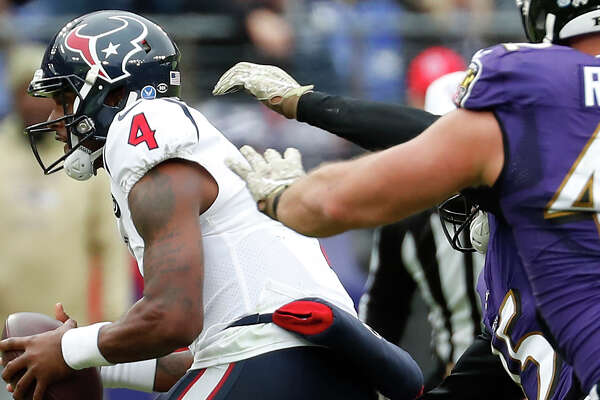 Houston Texans quarterback Deshaun Watson (4) is chased down by Baltimore Ravens defenders as he eventually is sacked during the first quarter of an NFL football game at M&T Bank Stadium on Sunday, Nov. 17, 2019, in Baltimore.
