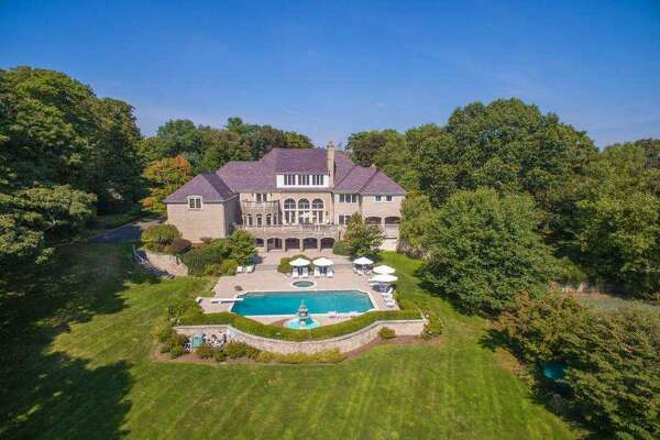 The Philbin home in backcountry Greenwich is on the market for $4.595 million, a substantial decline in value.