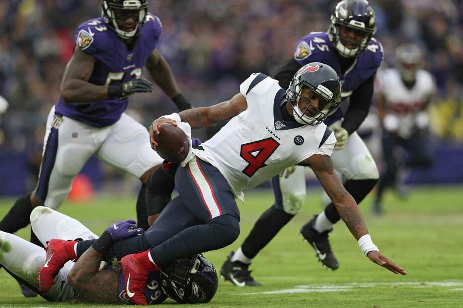 Quarterback Deshaun Watson (4) of the Houston Texans is sacked by outside linebacker Matt Judon (99) of the Baltimore Ravens during the third quarter at M&T Bank Stadium on November 17, 2019 in Baltimore, Maryland. Photo: Patrick Smith, Staff / Getty Images / 2019 Getty Images