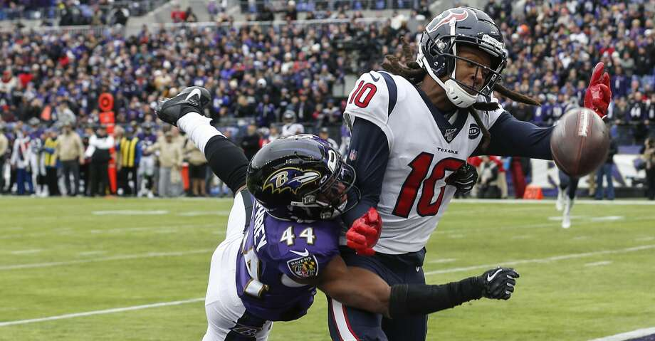 Baltimore Ravens cornerback Marlon Humphrey (44) breaks up a fourth down pass in the end zone intended for Houston Texans wide receiver DeAndre Hopkins (10) during the first quarter of an NFL football game at M&T Bank Stadium on Sunday, Nov. 17, 2019, in Baltimore. Photo: Brett Coomer/Staff Photographer