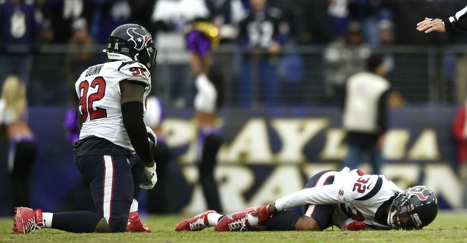 Houston Texans cornerback Lonnie Johnson holds his ankle after suffering an apparent injury during the second half of an NFL football game against the Baltimore Ravens, Sunday, Nov. 17, 2019, in Baltimore. (AP Photo/Gail Burton) Photo: Gail Burton/Associated Press