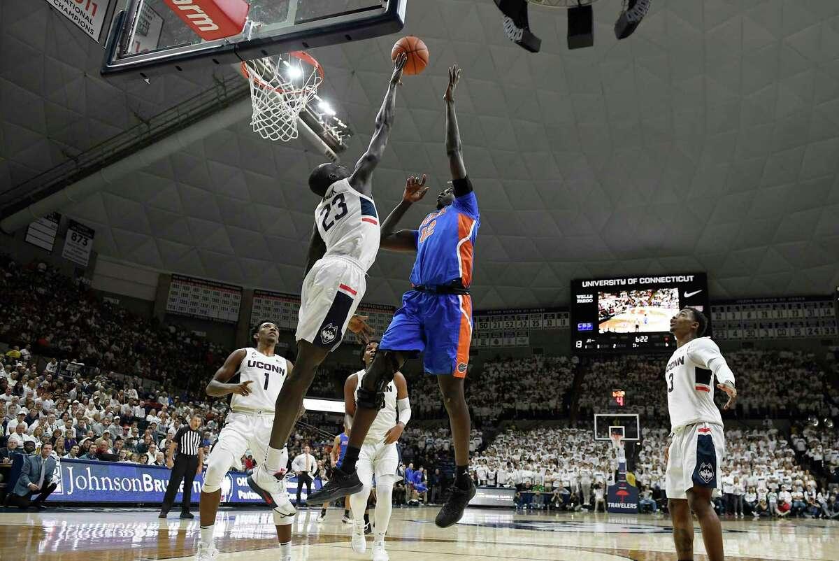 UConn's Akok Akok (23) blocks a shot by Florida's Gorjok Gak on Nov. 17.