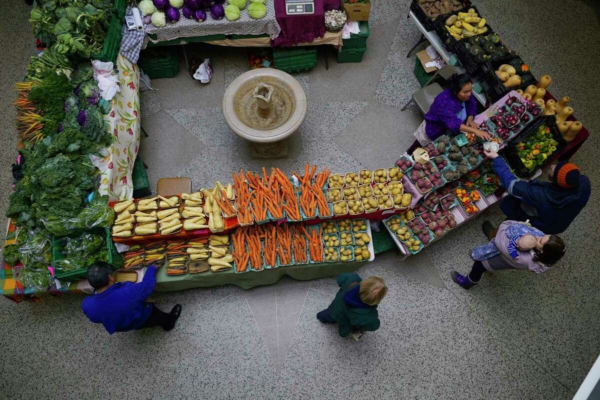 Customers buy vegetables at the Spa City Farmers' Market inside at the Lincoln Baths on Sunday, Nov. 17, 2019, in Saratoga Springs, N.Y. (Paul Buckowski/Times Union)