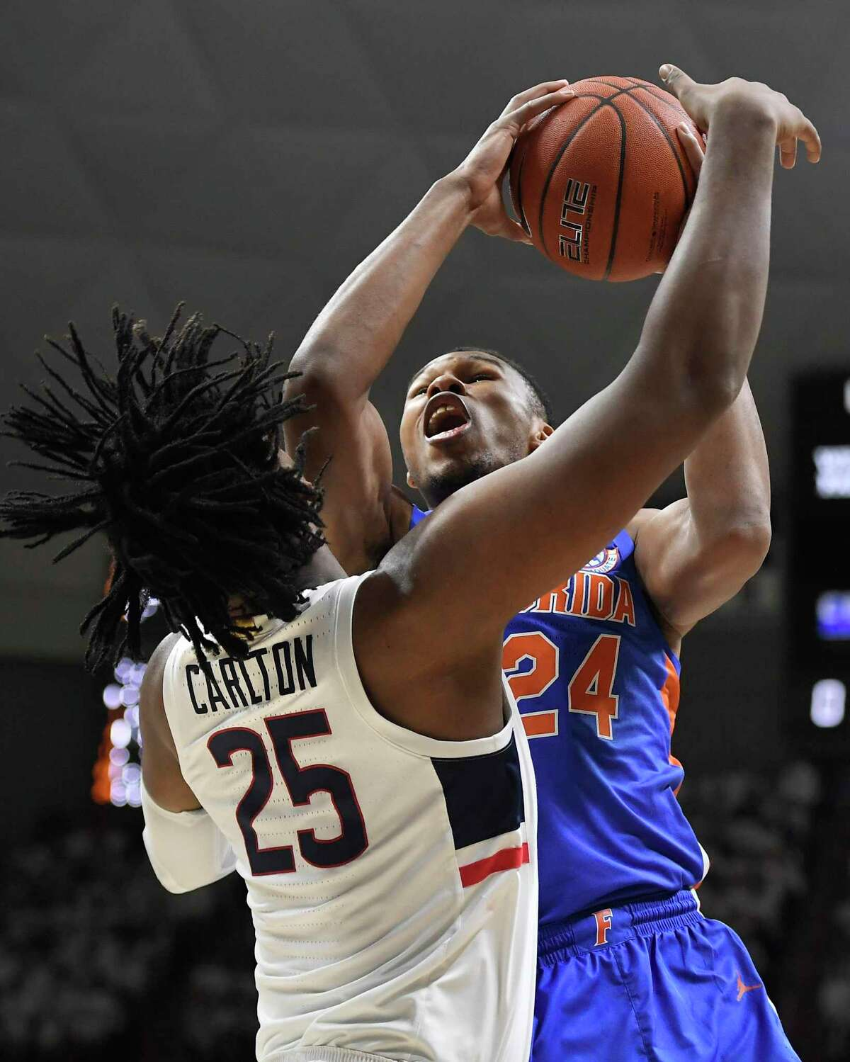 Florida's Kerry Blackshear Jr., right, shoots as UConn's Josh Carlton defends during the first half on Sunday in Storrs.