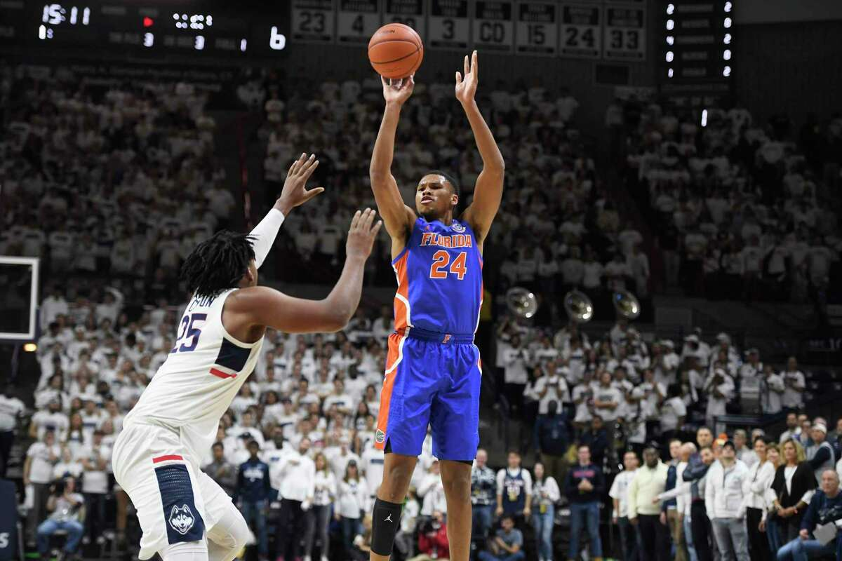 Florida's Kerry Blackshear Jr., right, shoots against UConn's Josh Carlton during the first half Sunday in Storrs.