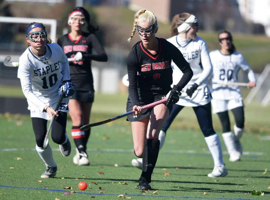 New Canaan's Emily Knight (8) gets to the ball in front of Staples' Laine Ambrose (10) during a CIAC Class L field hockey quarterfinal game in Westport on Saturday, Nov. 16, 2019. Photo: Dave Stewart / Hearst Connecticut Media / Hearst Connecticut Media