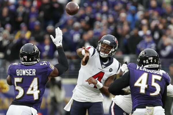 Houston Texans quarterback Deshaun Watson (4) throws a pass over Baltimore Ravens linebacker Tyus Bowser (54) during the fourth quarter of an NFL football game at M&T Bank Stadium on Sunday, Nov. 17, 2019, in Baltimore.