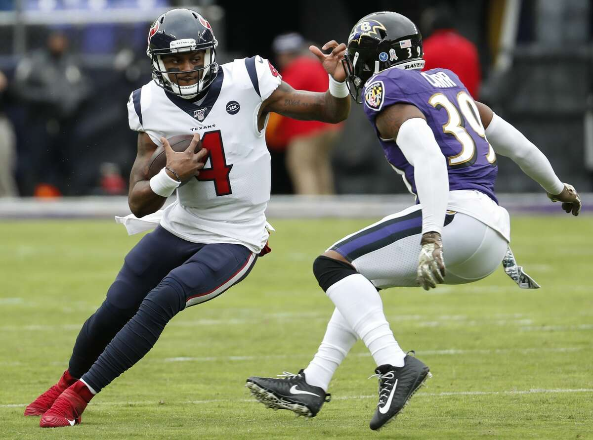 Houston Texans quarterback Deshaun Watson (4) is chased out of the pocket by Baltimore Ravens cornerback Brandon Carr (39) during the first quarter of an NFL football game at M&T Bank Stadium on Sunday, Nov. 17, 2019, in Baltimore.