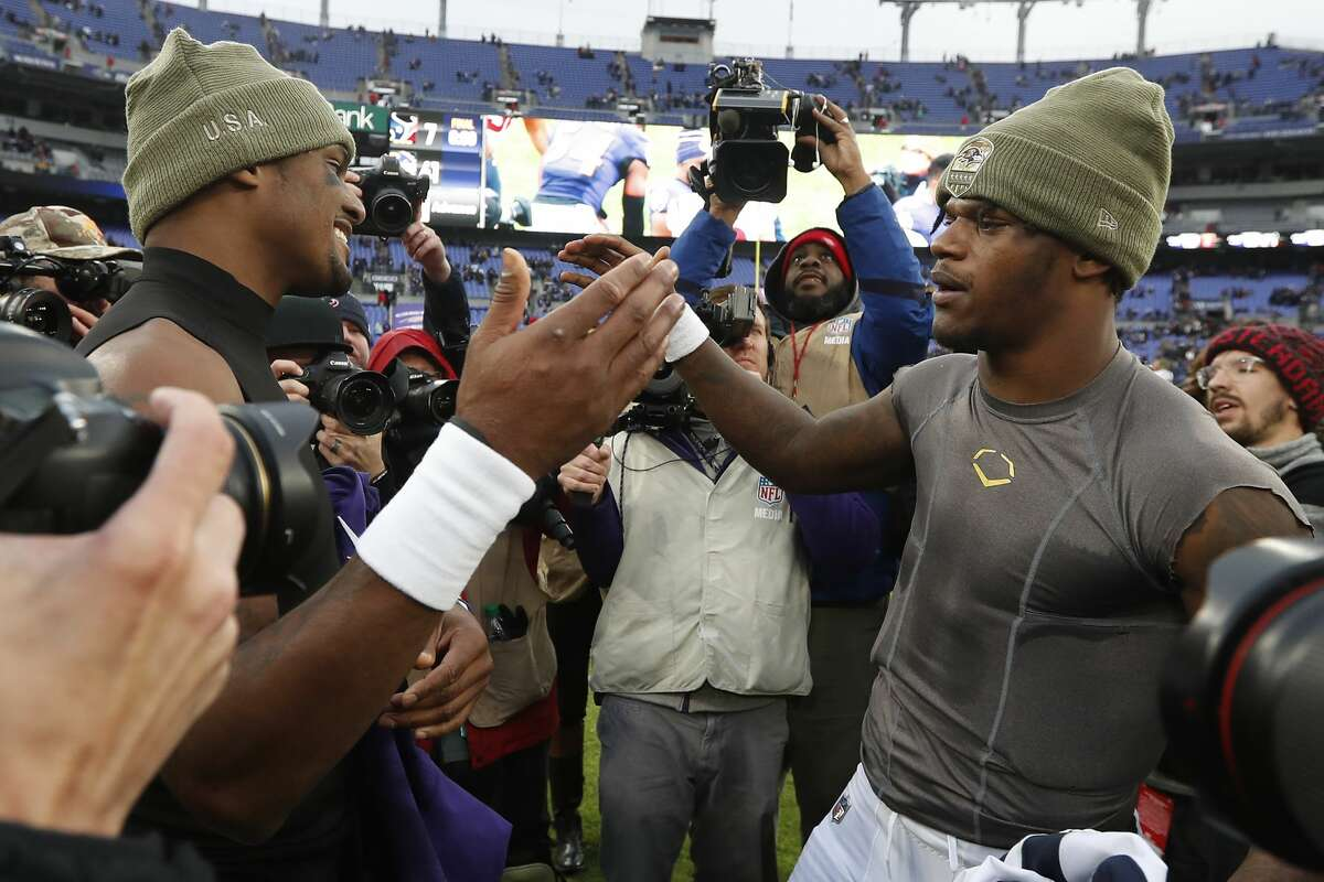 Houston Texans quarterback Deshaun Watson, left, and Baltimore Ravens quarterback Lamar Jackson shake hands after an NFL football game at M&T Bank Stadium on Sunday, Nov. 17, 2019, in Baltimore.