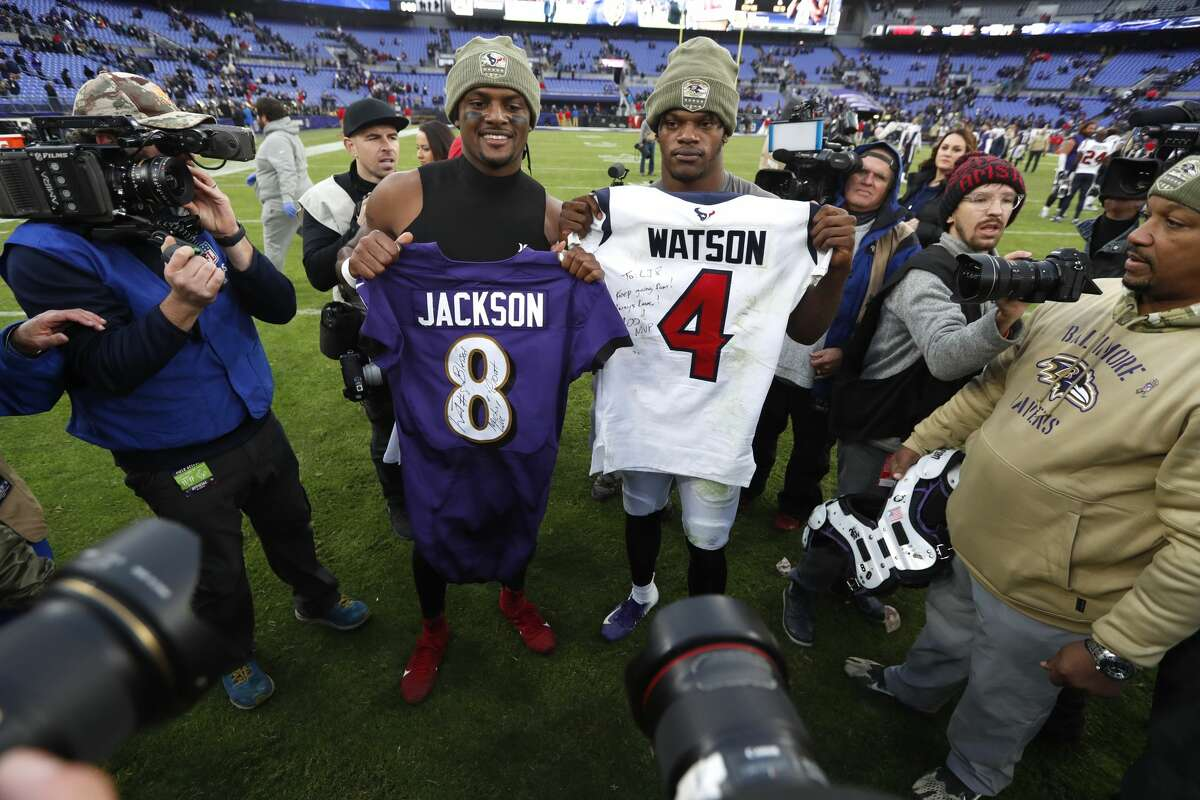 Houston Texans quarterback Deshaun Watson, left, and Baltimore Ravens quarterback Lamar Jackson pose for photos after trading jerseys after an NFL football game at M&T Bank Stadium on Sunday, Nov. 17, 2019, in Baltimore.