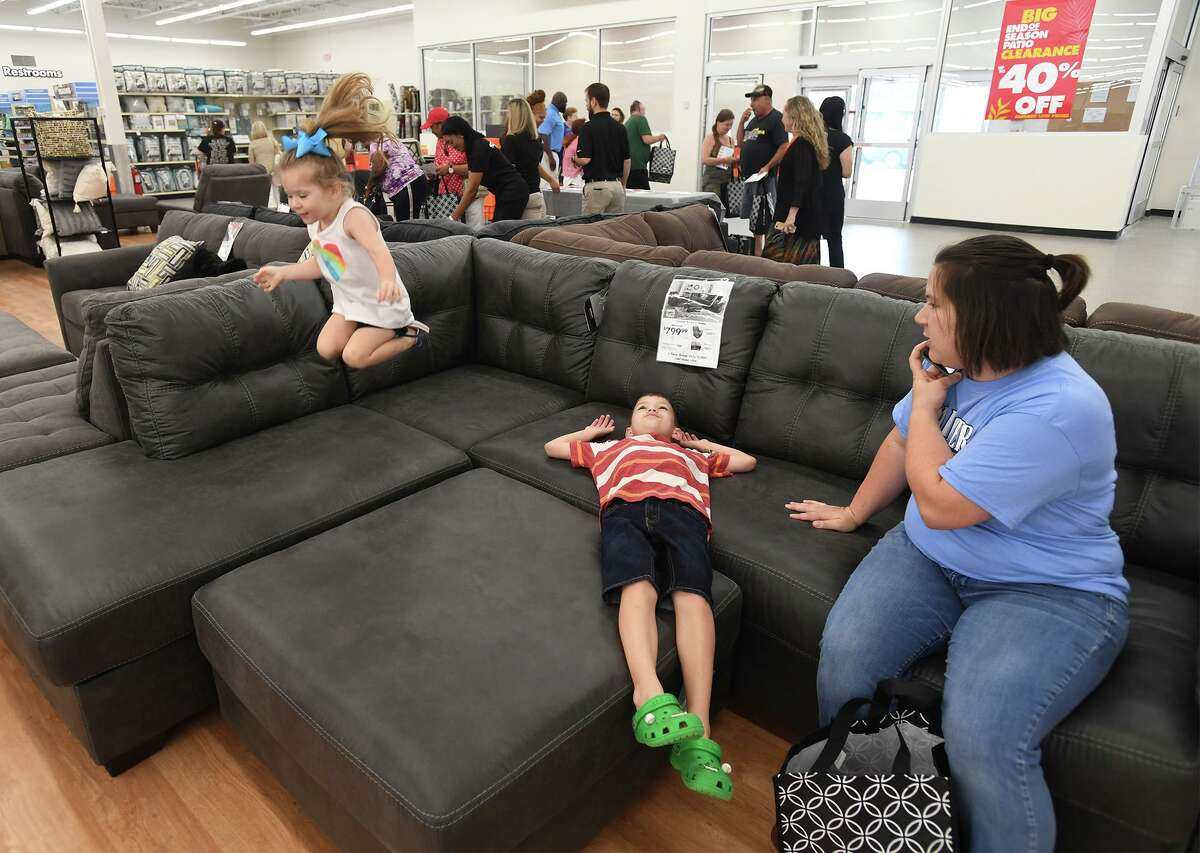 Ella Bird, 3, Luke Bird, 7, and Shay Bird sample a couch while shopping at Beaumont's new Big Lots early Friday morning. While the store opened two weeks ago, a grand opening was held Friday. Photo taken Friday, 6/7/19