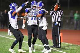 Darien's Will Kirby (21) at right, celebrates his first half touchdown against Norwalk in a FCIAC football game at Norwalk High School Testa Field on Nov. 15, 2019 in Norwalk Connecticut.