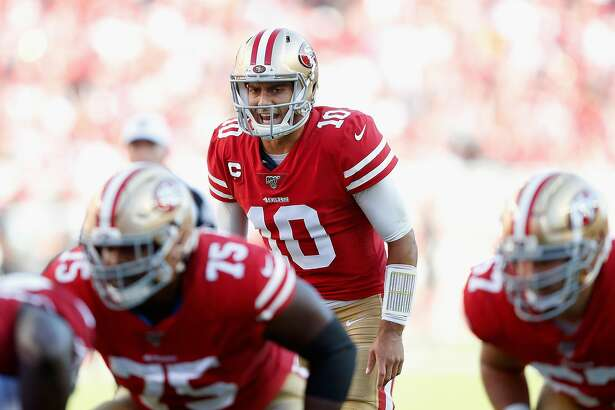 SANTA CLARA, CALIFORNIA - NOVEMBER 17: Quarterback Jimmy Garoppolo #10 of the San Francisco 49ers prepares to snap the football against the Arizona Cardinals during the first half of the NFL game at Levi's Stadium on November 17, 2019 in Santa Clara, California. (Photo by Lachlan Cunningham/Getty Images)