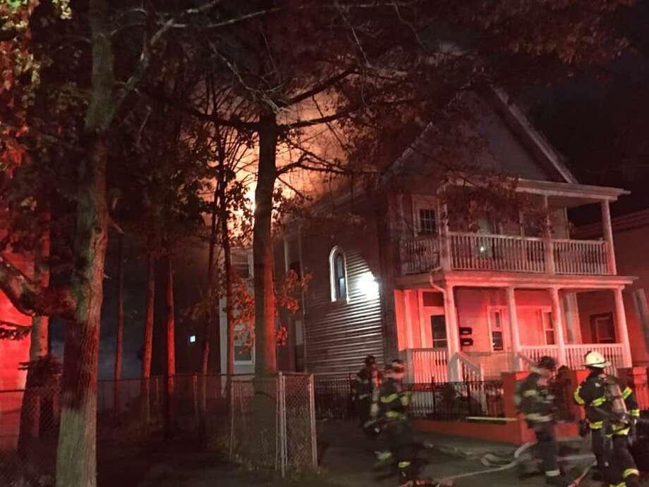 Firefighters were battling a blaze at a Gilbert Avenue address on Nov. 17, 2019. Photo: Gary Guglielmo/New Haven Fire Twitter / Contributed