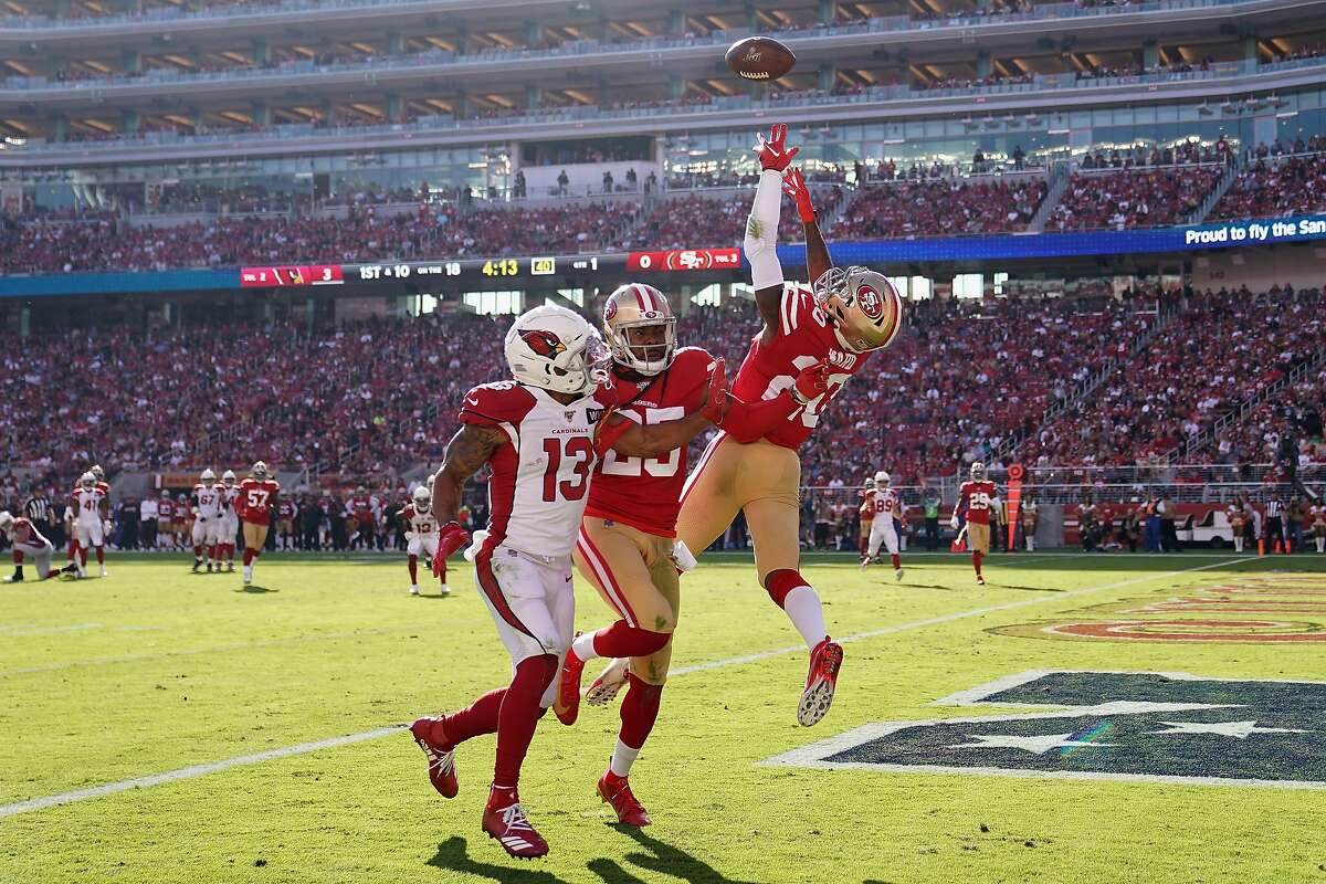 Cornerback Jimmie Ward #20 of the San Francisco 49ers makes a defensive play over wide receiver Christian Kirk #13 of the Arizona Cardinals during the first half of the NFL game at Levi's Stadium on November 17, 2019 in Santa Clara, California.