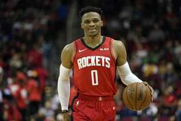 Houston Rockets' Russell Westbrook (0) brings the ball up the court against the Golden State Warriors during the second half of an NBA basketball game Wednesday, Nov. 6, 2019, in Houston. The Rockets won 129-112. (AP Photo/David J. Phillip)